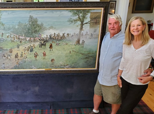 Dale and Anne with the oil painting Farmers Against the Crown. Released 2021